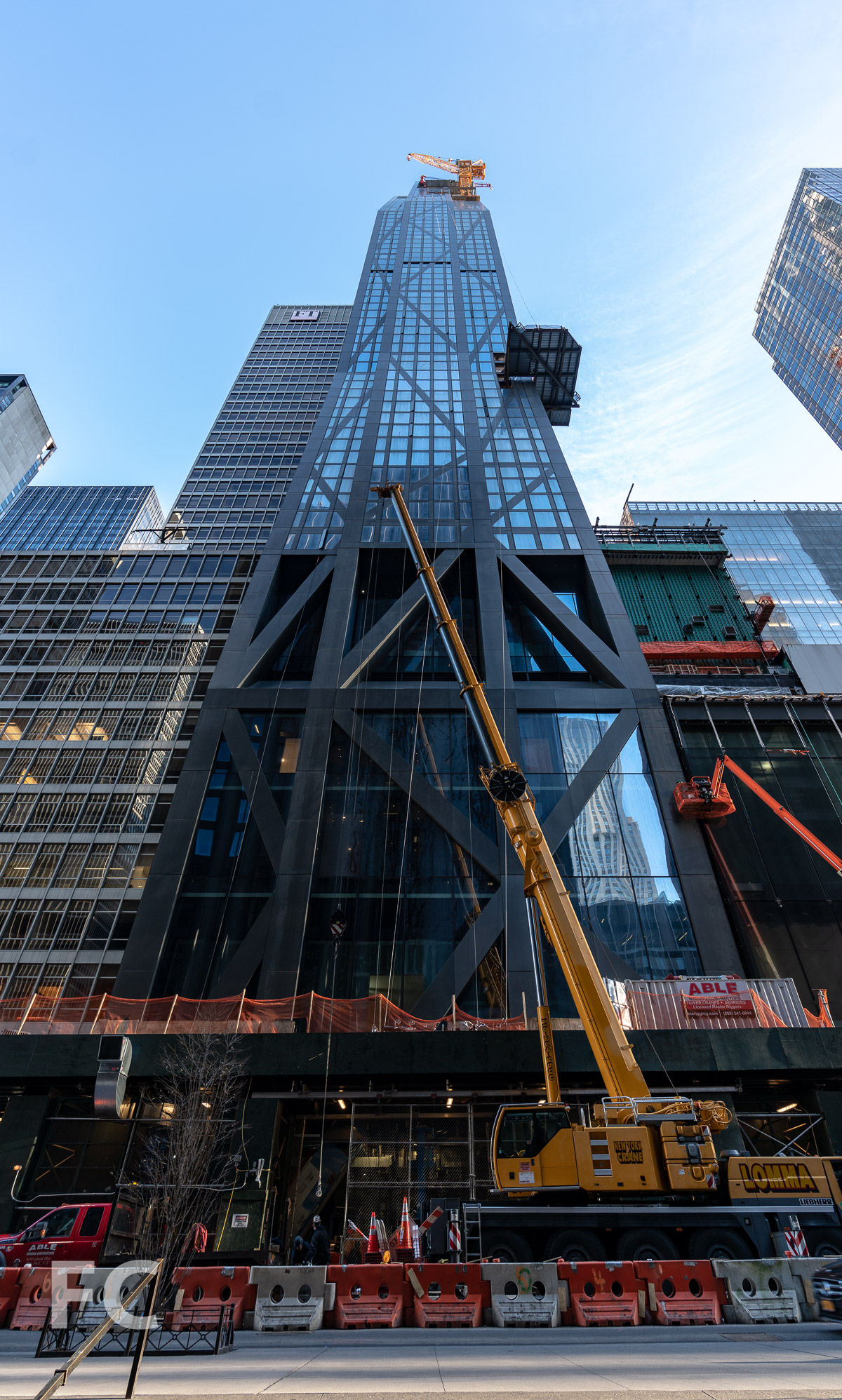 Looking up at the south facade from West 53rd Street.