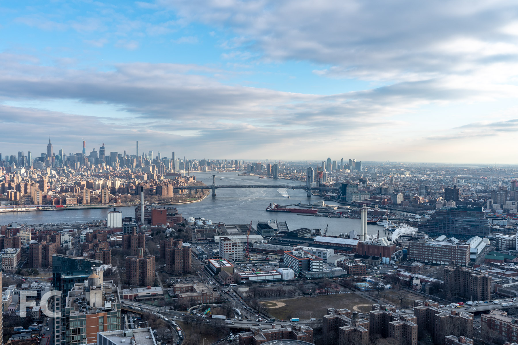 View north towards Lower Manhattan and the Brooklyn waterfront from an upper floor.
