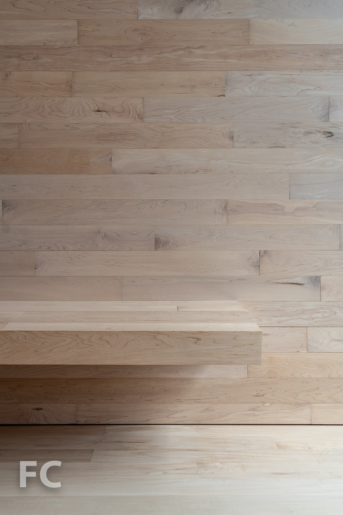 Detail of the maple wall, flooring, and bench.