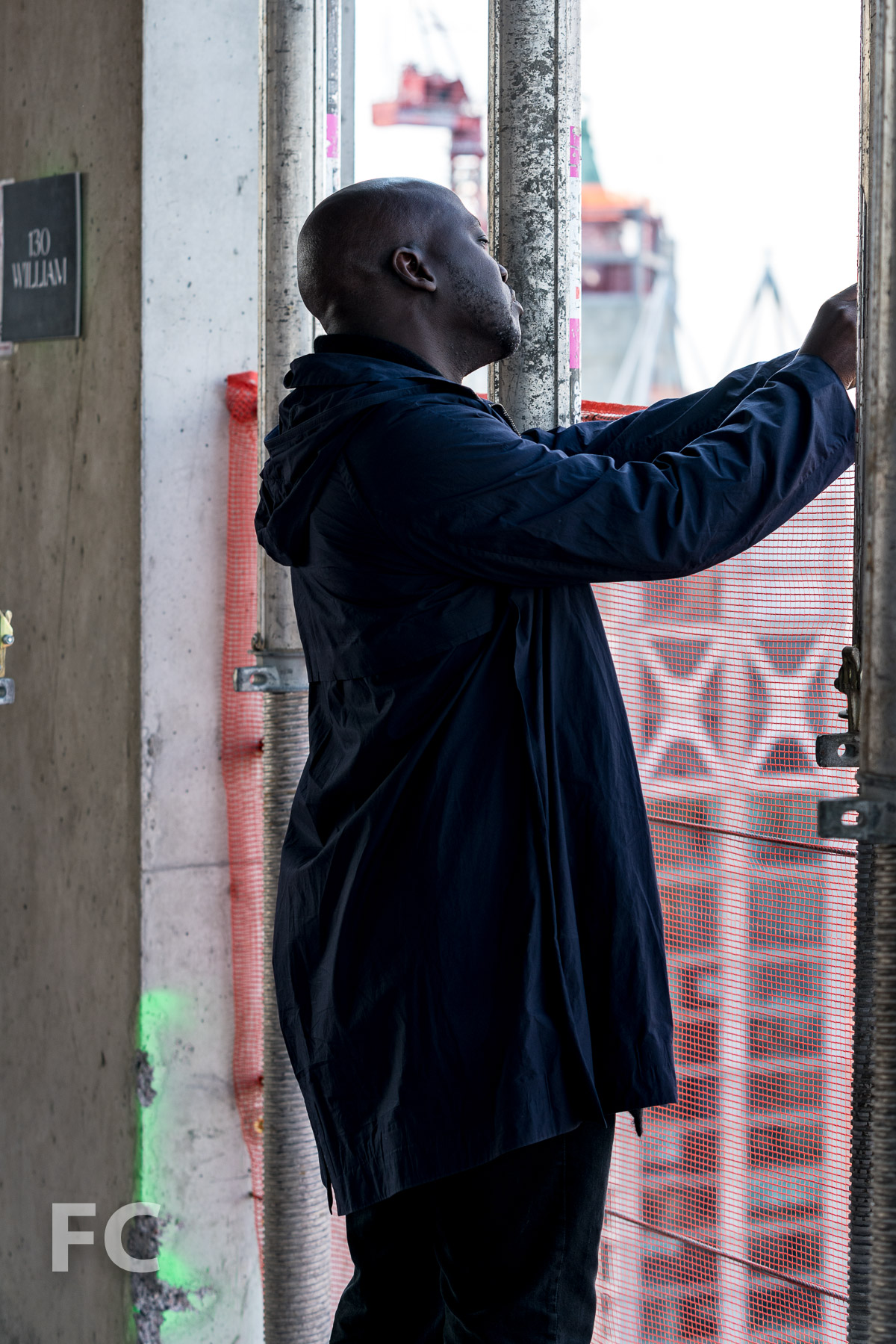 Architect David Adjaye capturing the view from the top of 130 William.