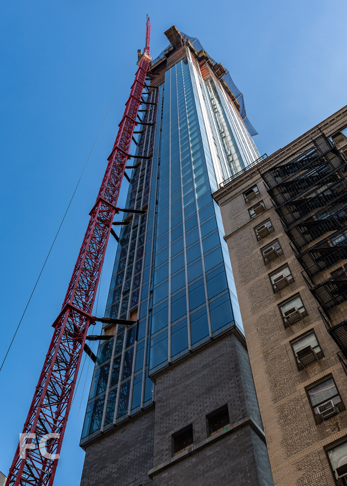 Looking up at the south facade from East 30th Street.