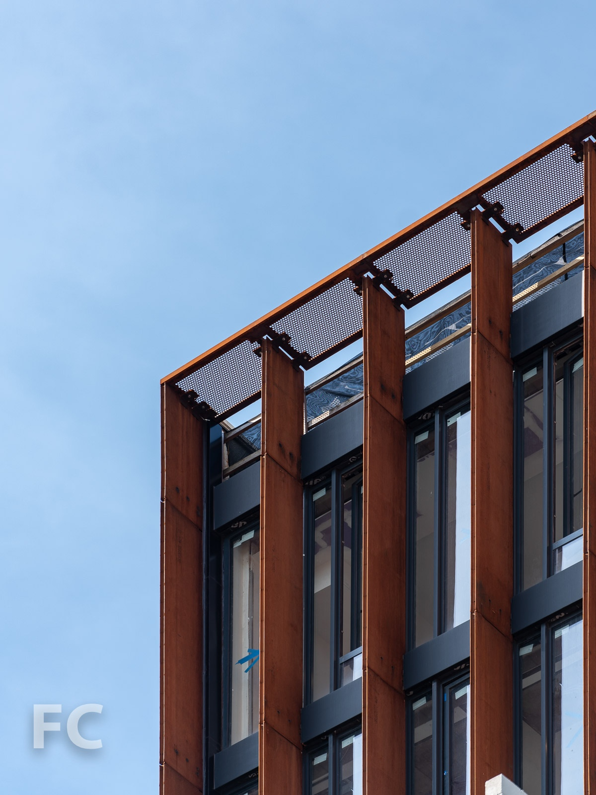 Close-up of the corten steel fins on the setback floors of the north facade.