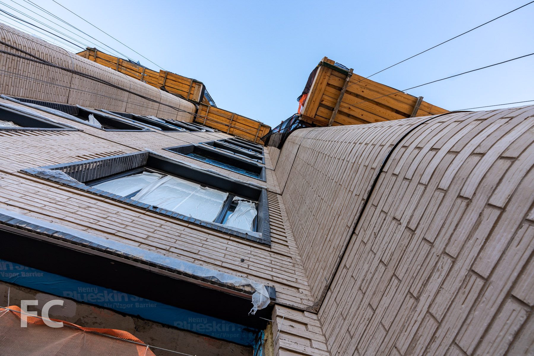 Looking up at the rounded brick corners.