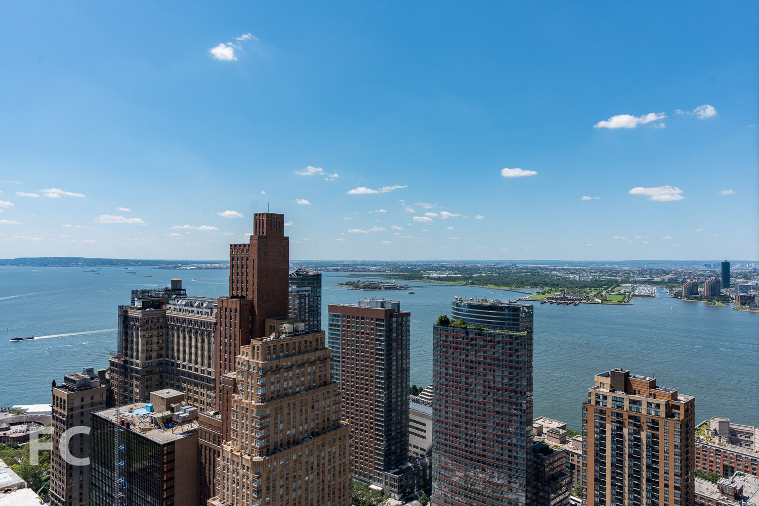 View southwest towards Battery Park City and Jersey City from the top floor.