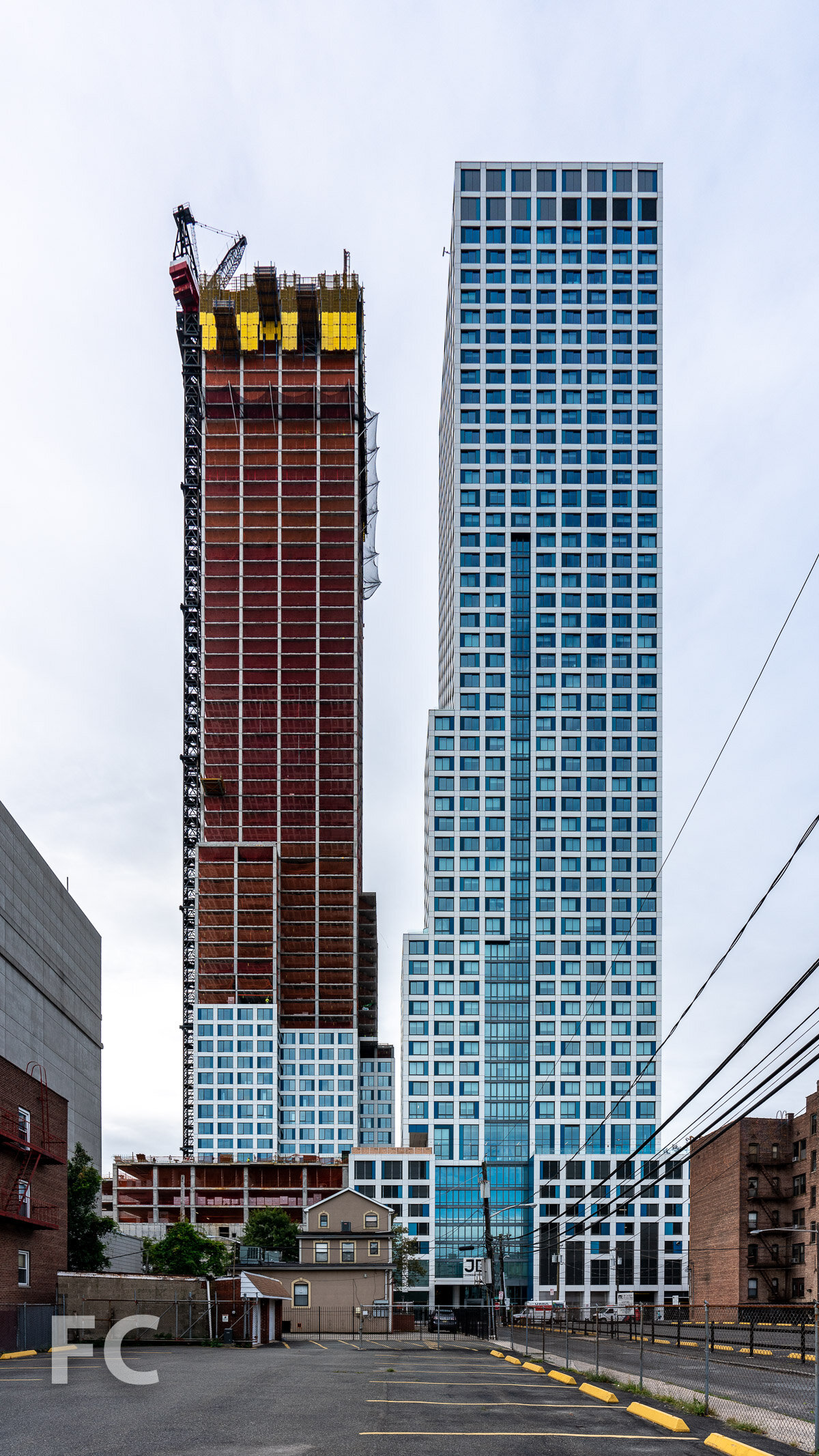 North facade of phase one (right) and phase two (left) from Van Reipen Avenue.