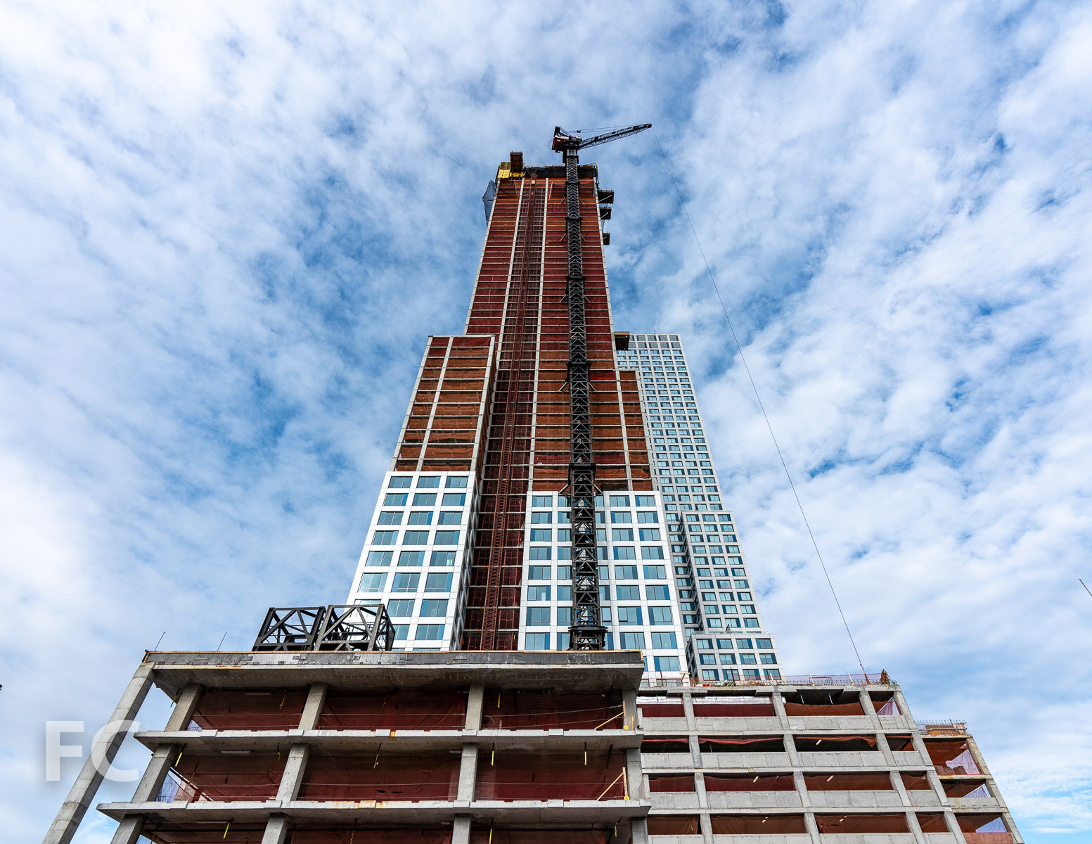 Looking up at the east facade of phase two from Summit Avenue.