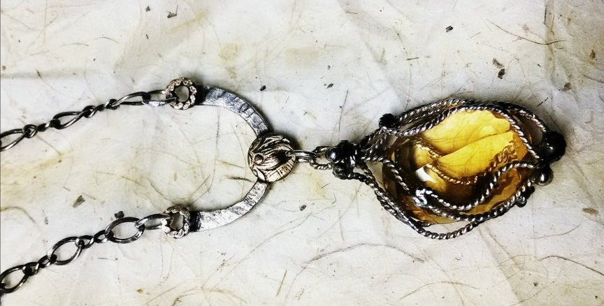 This 2014 commission took me back to my first designs where I instinctively created loose 'nets or cages' for pieces.    *Custom piece for Monique. Hand-fabricated, oxidized, sterling-mix 'net' for her very special citrine.