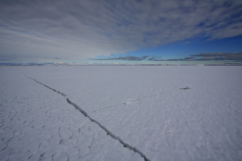 The tide crack where the fast ice meets the sea ice.