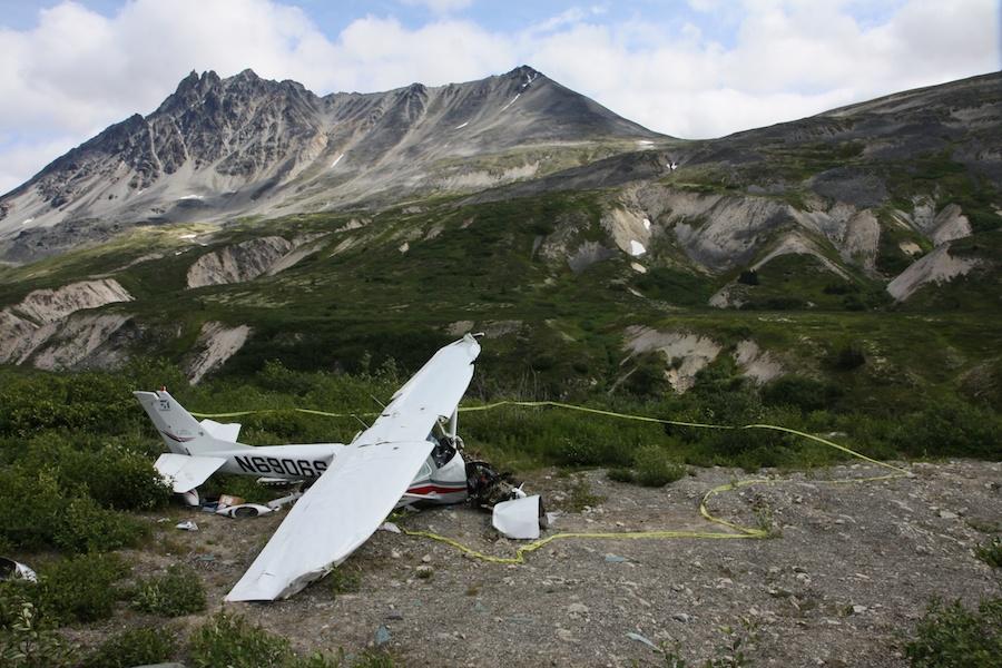 Crashed plane along the roadside.