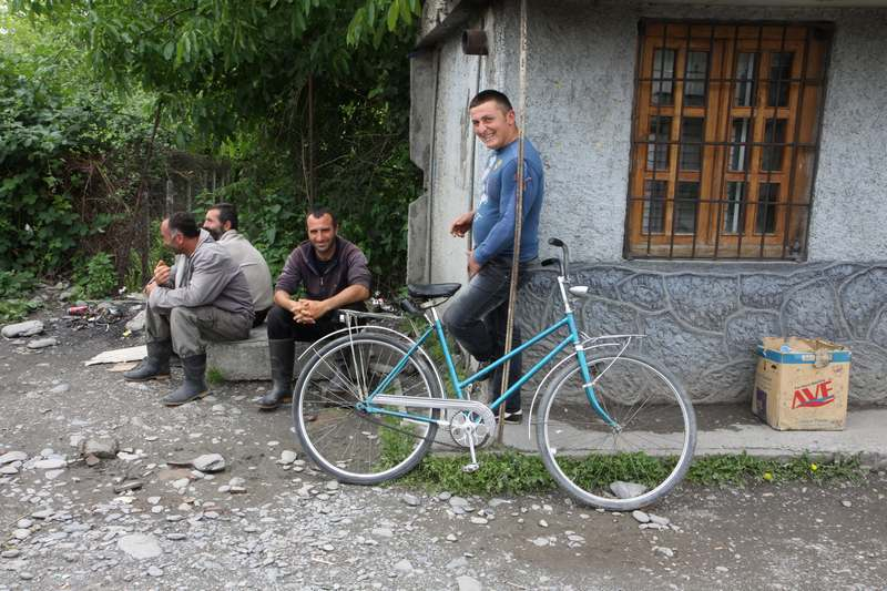 Georgian cyclists in a small village