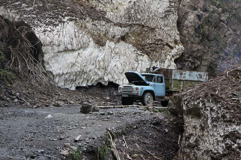 Old trucks tacking firewood from an avalanche debris