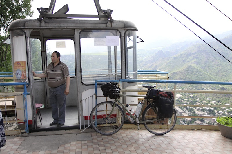 Riding the ancient cable car up to the village above.