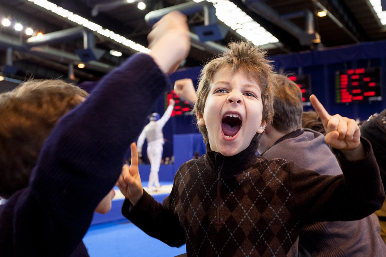 Jeune supporter enthousiaste suite à la victoire d'un joueur de l'équipe de France. Challenge international de Paris, 27 janvier 2013. © Sébastien Borda