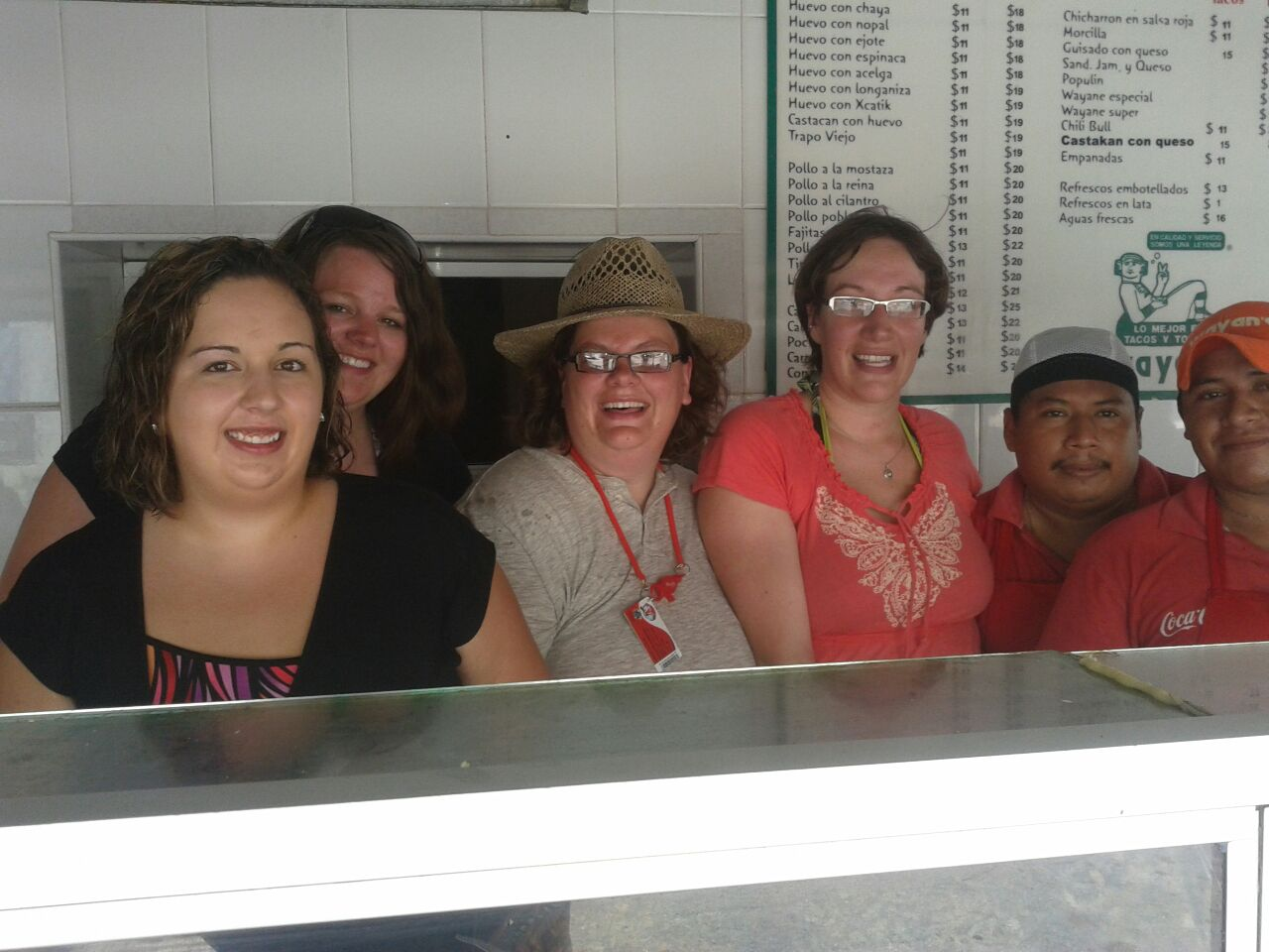 Here is the happy group INSIDE the taco kitchen with some of the staff!