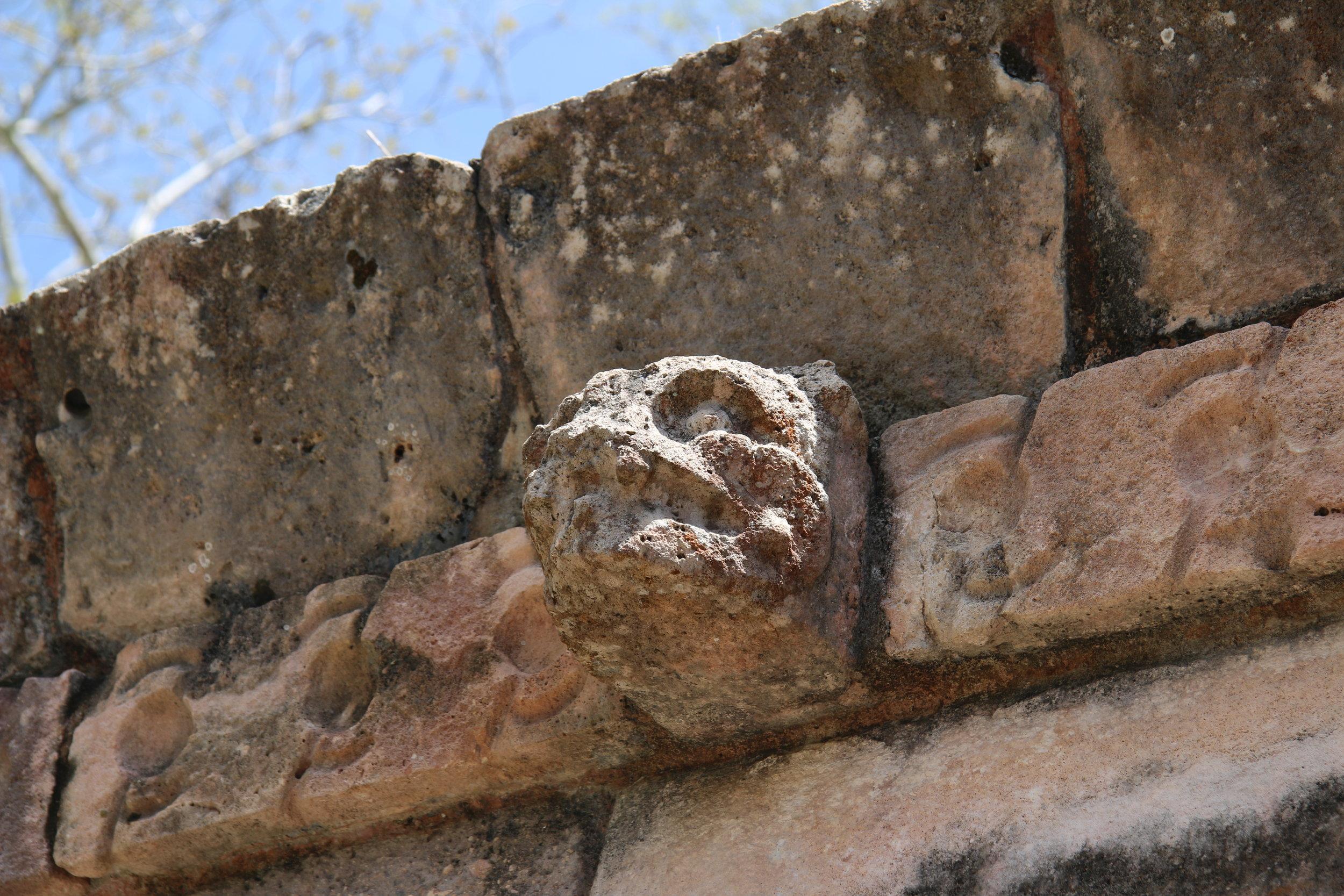 A jaguar head in stone