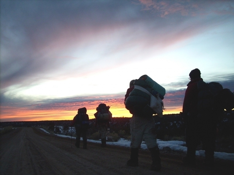group-hiking-at-sunset-in-winter.jpg