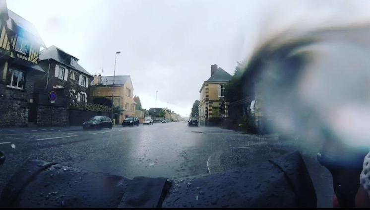 Rain and hail washing up over my handlebars at the Saint-Lô city limits.