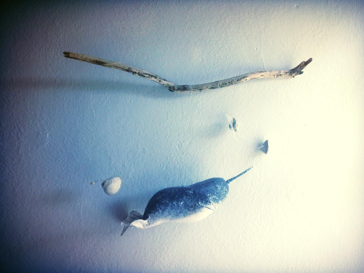 Handmade eco-friendly green baby mobile: narwhal and fish from shells