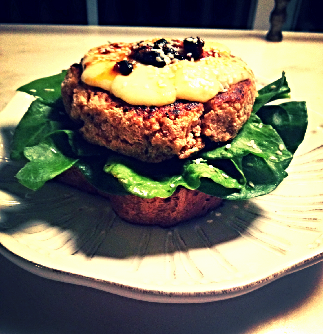 To serve it: I threw some Irish cheese on top, put in on a thick slice of crusty, whole grain bread, added some yellow chard and sorrel leaves for a lemon-ey flavor, then topped it off with a bit of pepper oil and sesame seeds.