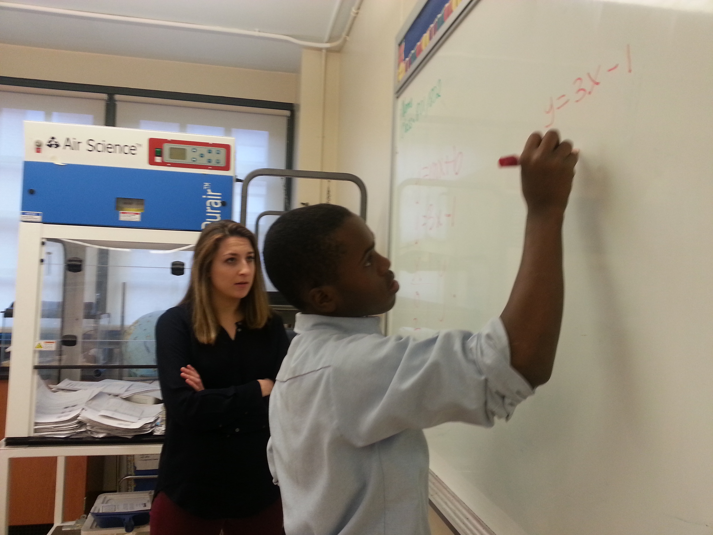 HLL volunteer Katherine Stewart working with Ryan, an 8th grader at Truth.