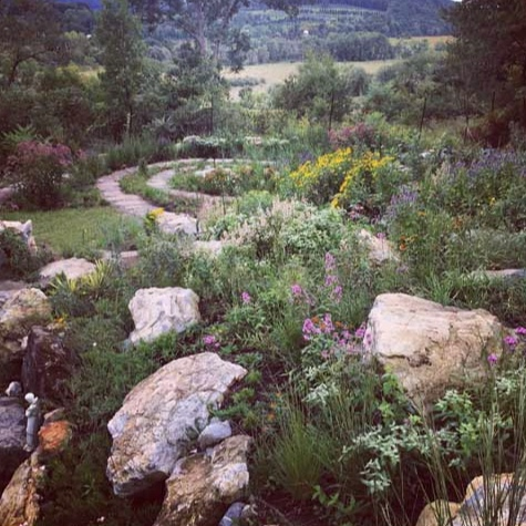 Native plantings along meditation spiral blend seamlessly with borrowed views