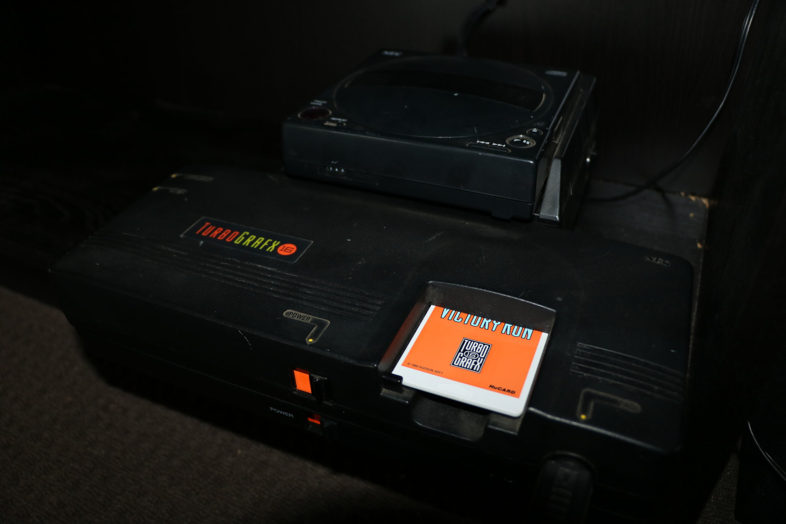 A Victory Run TurboChip inserted into a TurboGrafx 16. On top a TurboGrafx CD is attached.
