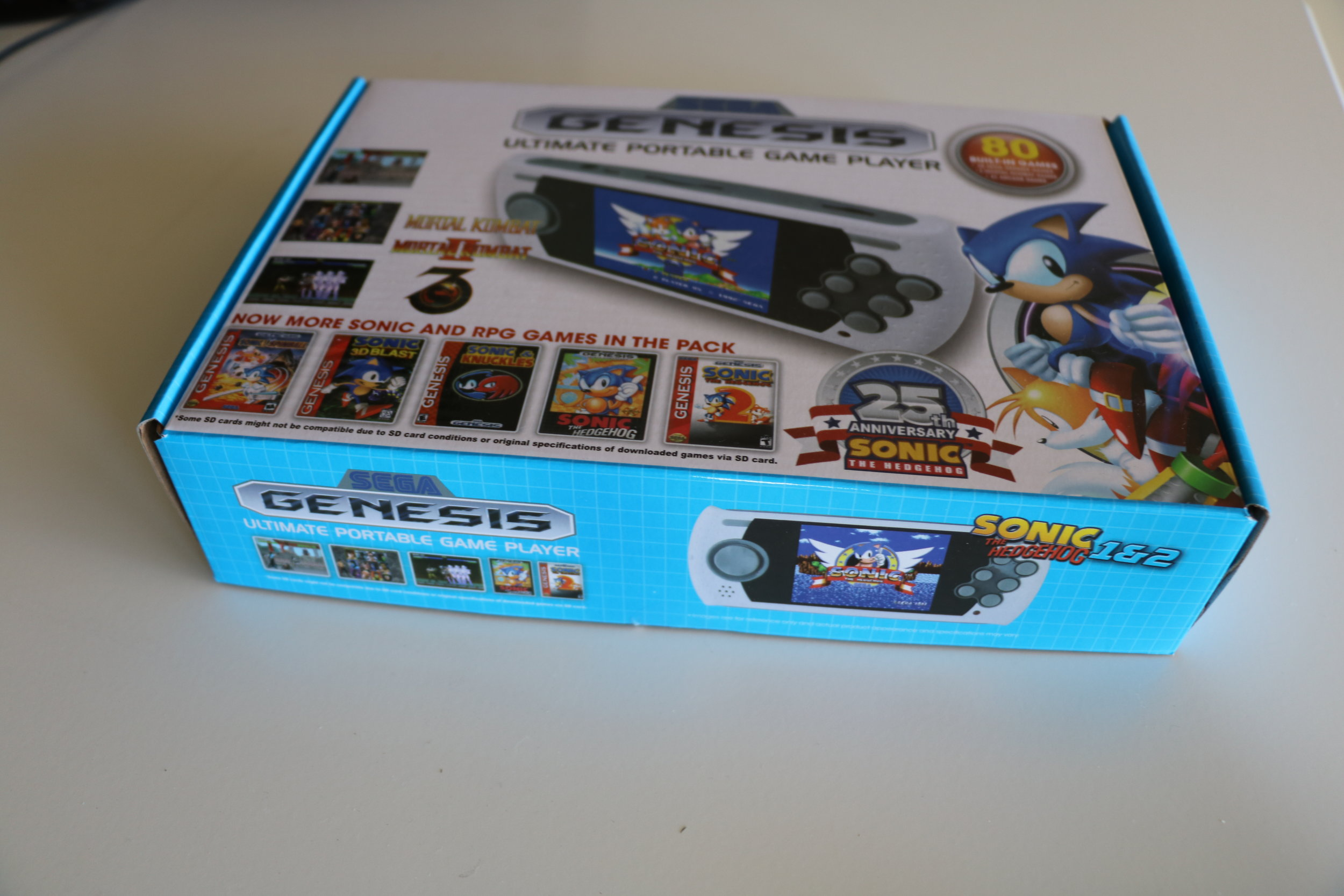 You can find the SEGA Genesis Ultimate Portable Game Player on Ebay for about $80 AUD.
