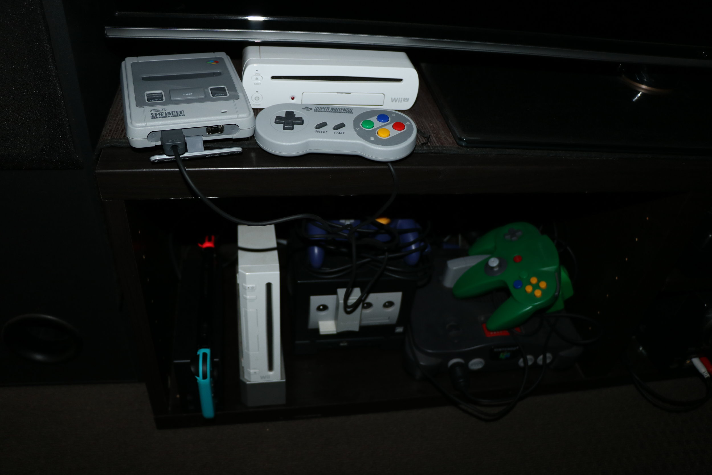 Sits nicely in the Nintendo section. (The NES and SNES have moved to the shelf now that the Retron 5 is hooked up).