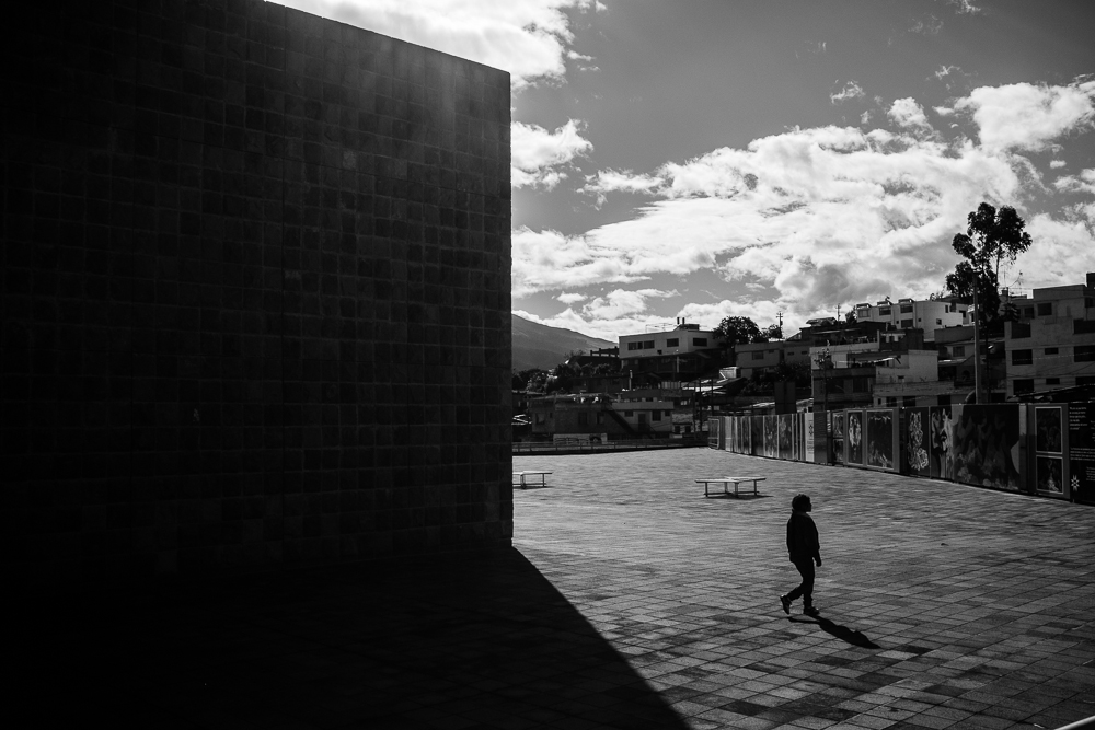 A woman walks across the courtyard outside Ecuadorean artist, Oswaldo Guayasamin's, Capilla del Hombre in Quito, 15 June 2014. ©Bear Guerra