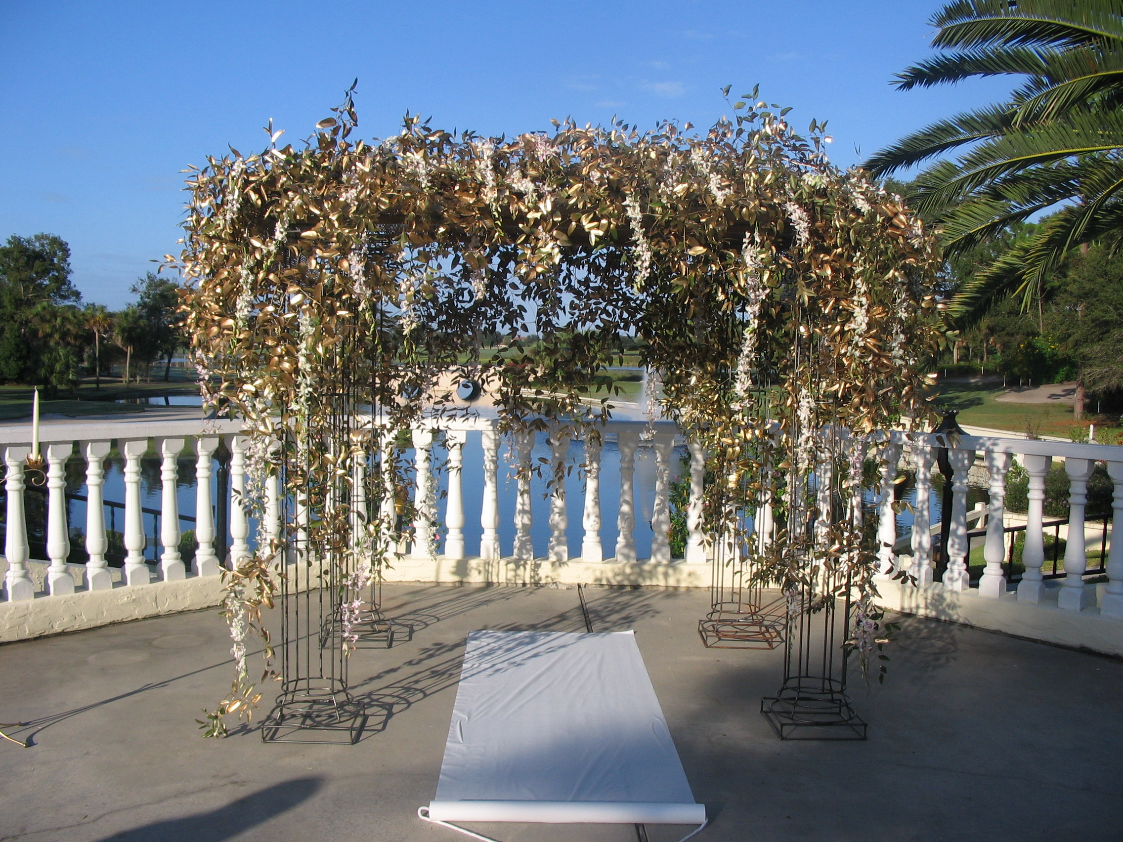 Wrought Iron Archway/Gazebo- $350  (Additional charges for Foliage and Flowers as seen in picture.)