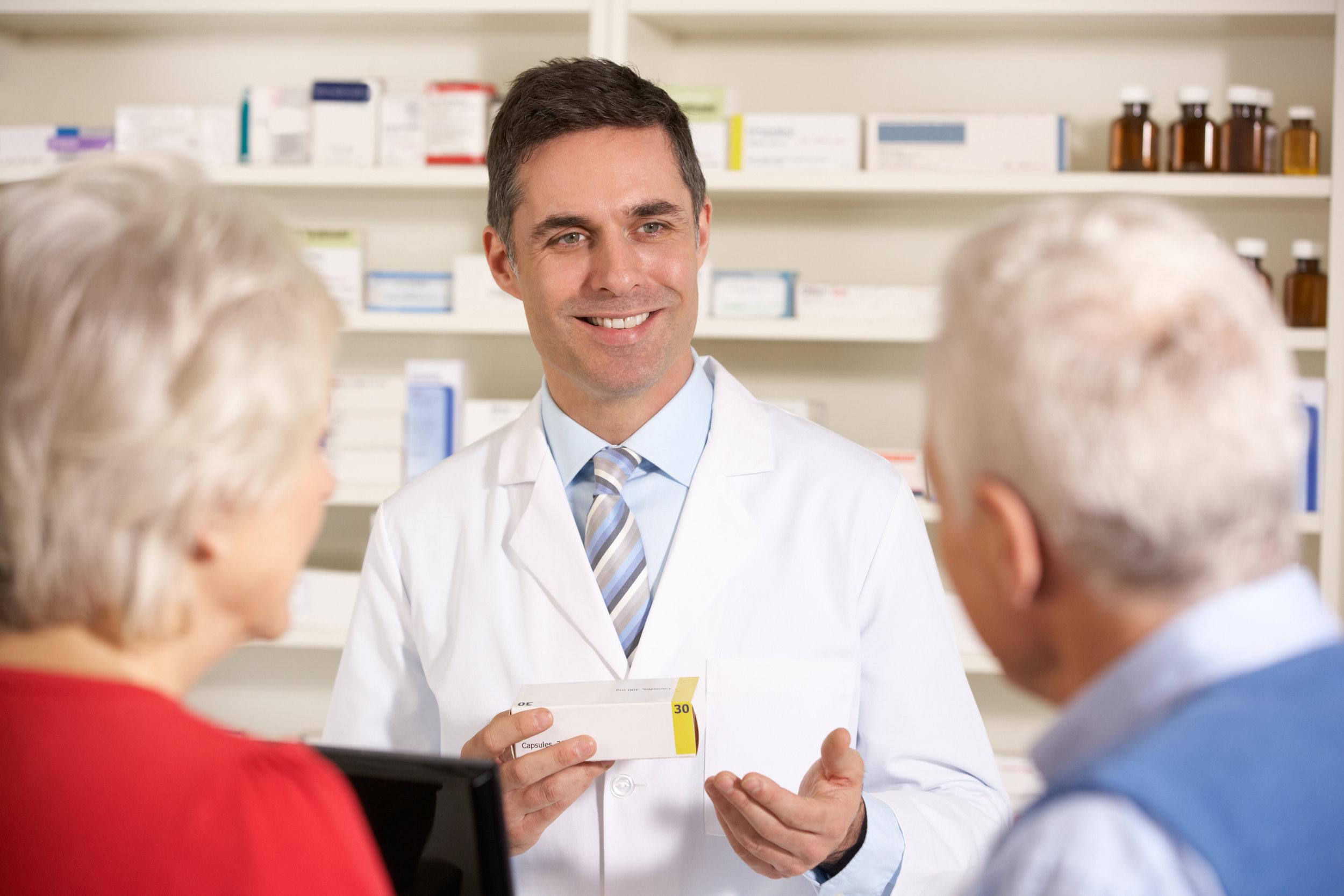 American pharmacist with senior couple in pharmacy dreamstime_xxl_23958449.jpg