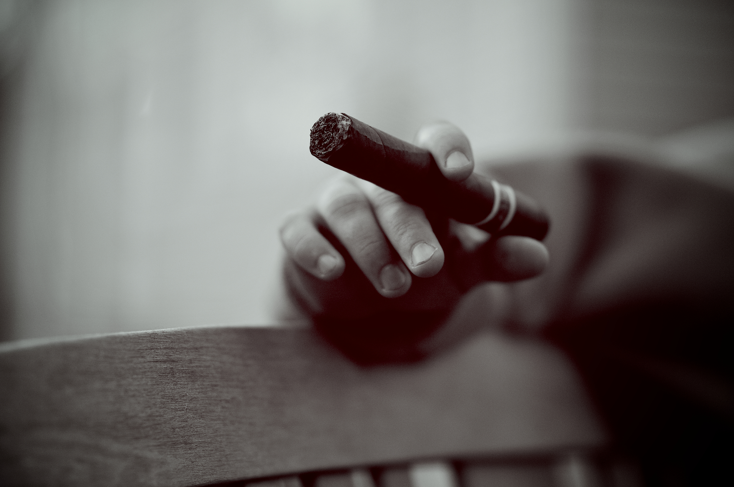 shallow depth of field image of a cigar in black and white. Photo by Joe Horvath