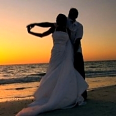 stock-footage-bride-groom-in-silhouette-dancing-at-sunset-on-the-beach-after-their-wedding-filmed-at-fps.jpg