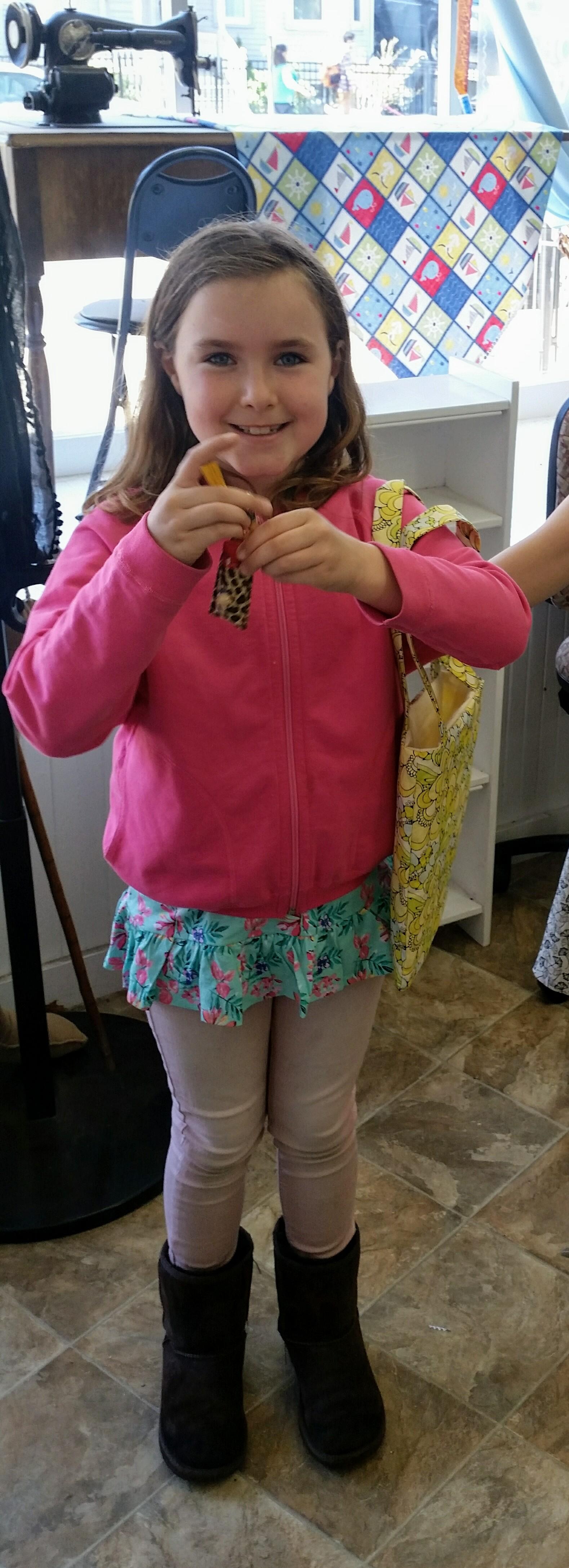 Georgia with her creations - chapstick holder and a handbag!