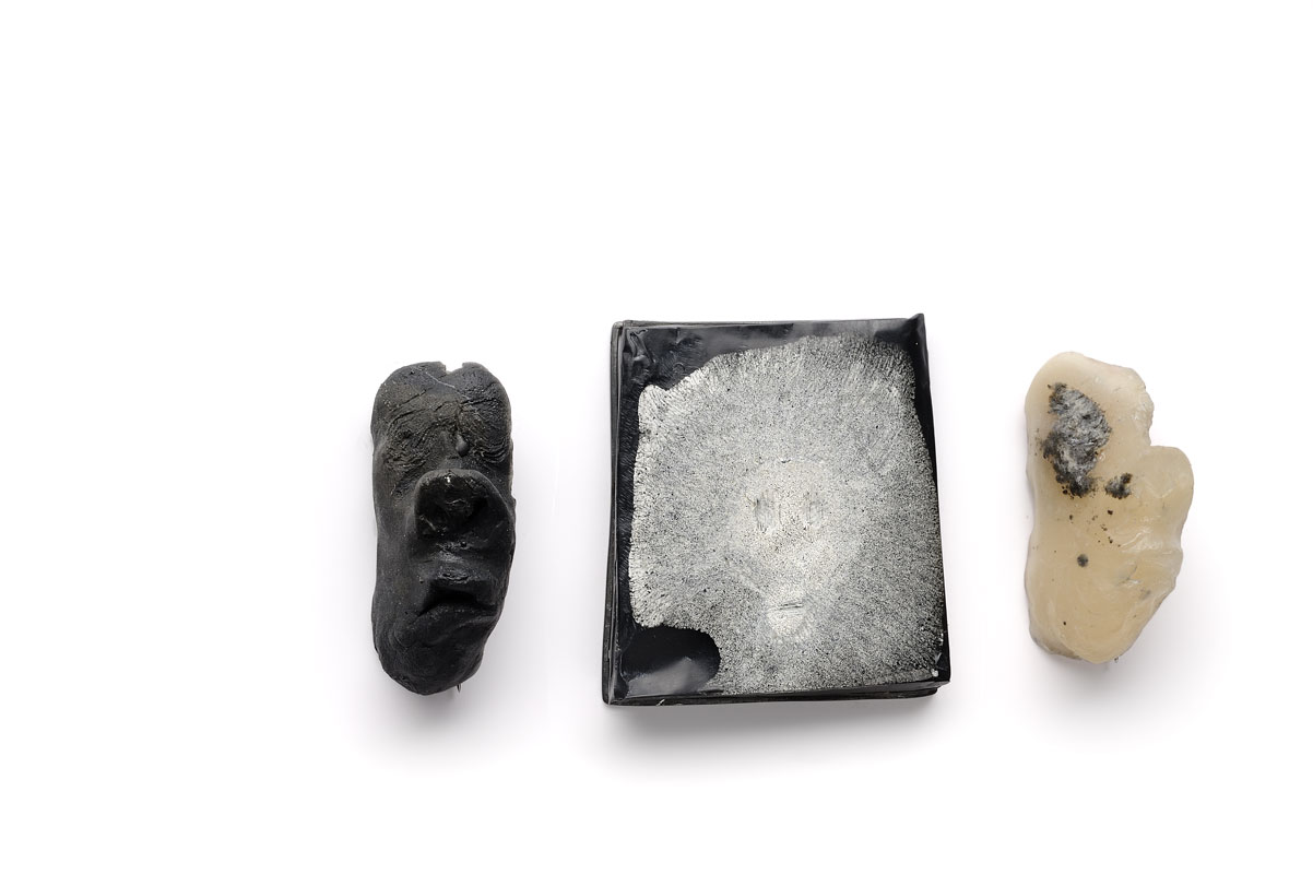 Brooches  Resin, pigments, sterling silver.  face on the left and right 5 x 2 cm 