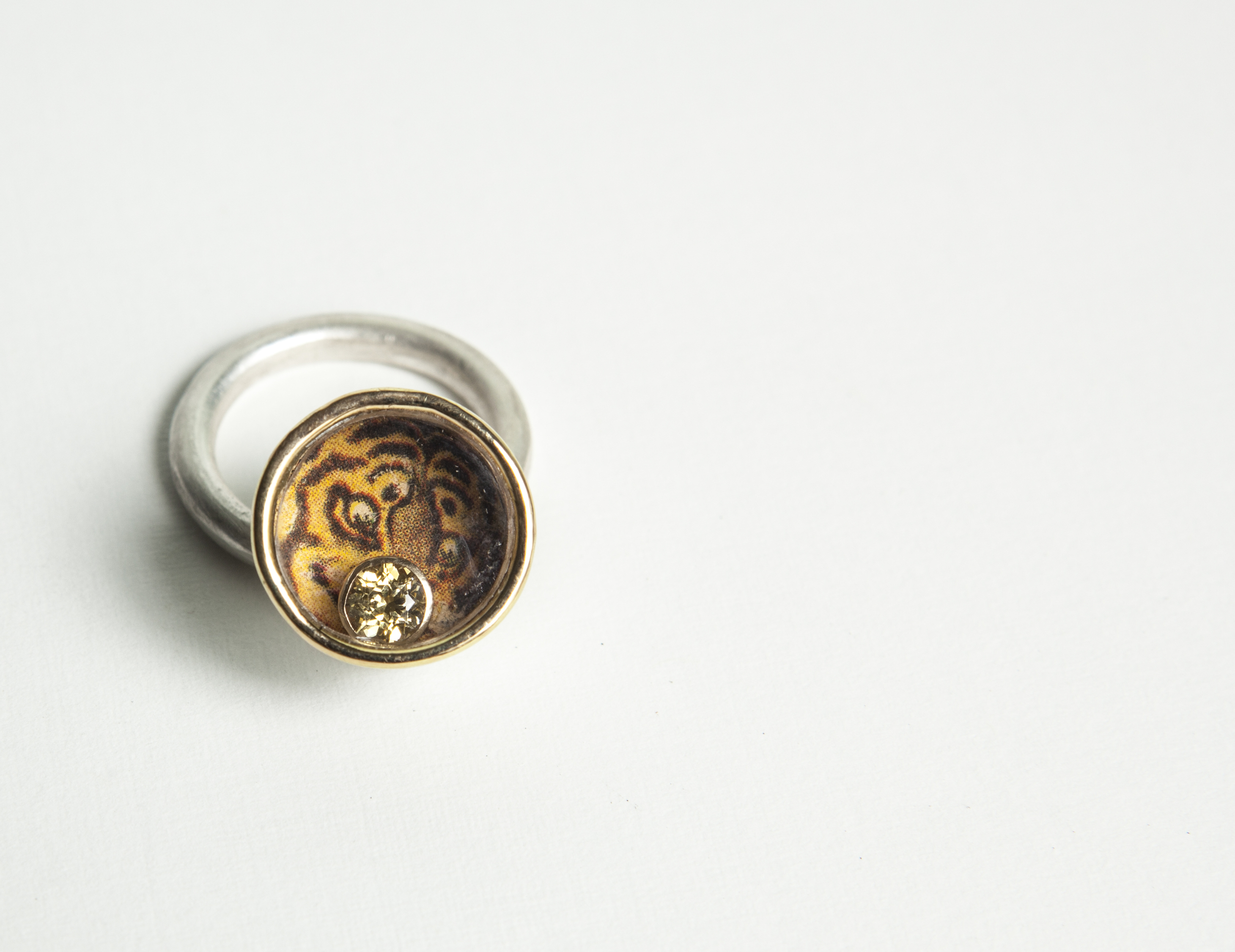 Ring  Sterling silver, gold, paper, 5mm yellow sapphire.  