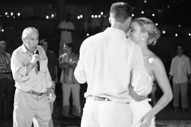 Wedding couple dancing as the grandfather of the bride sings live