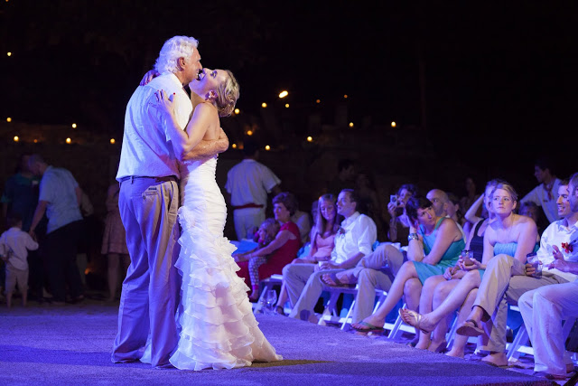 Bride and father dancing alone in the dance floor