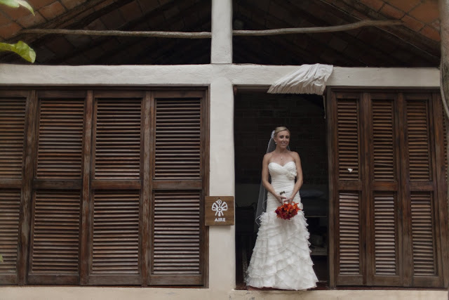 Bride standing by herself inside one of the little cabanas at Las Caletas, Puerto Vallarta, MX