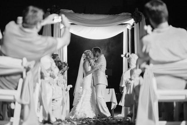 Couple's first kiss on their wedding ceremony