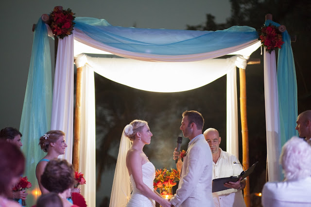 Groom saying his vows during the destination wedding ceremony at dusk