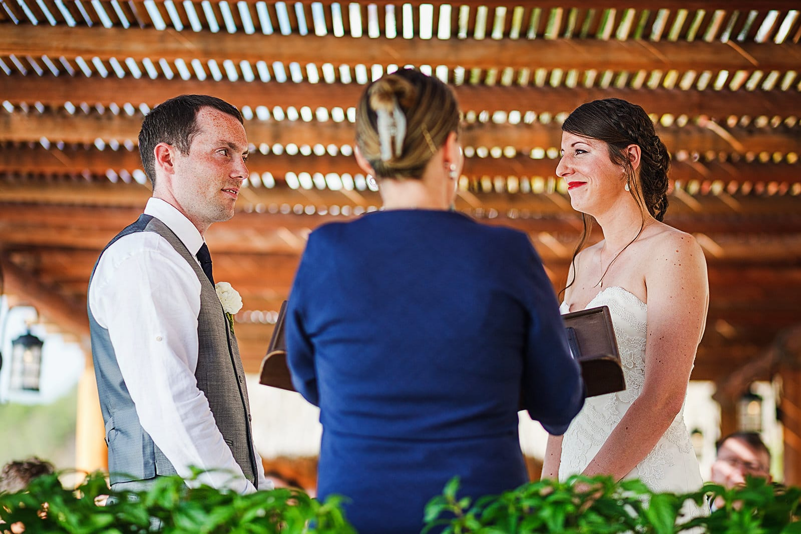 Bride and groom stare at each other during wedding ceremony at Playa Fiesta terrace