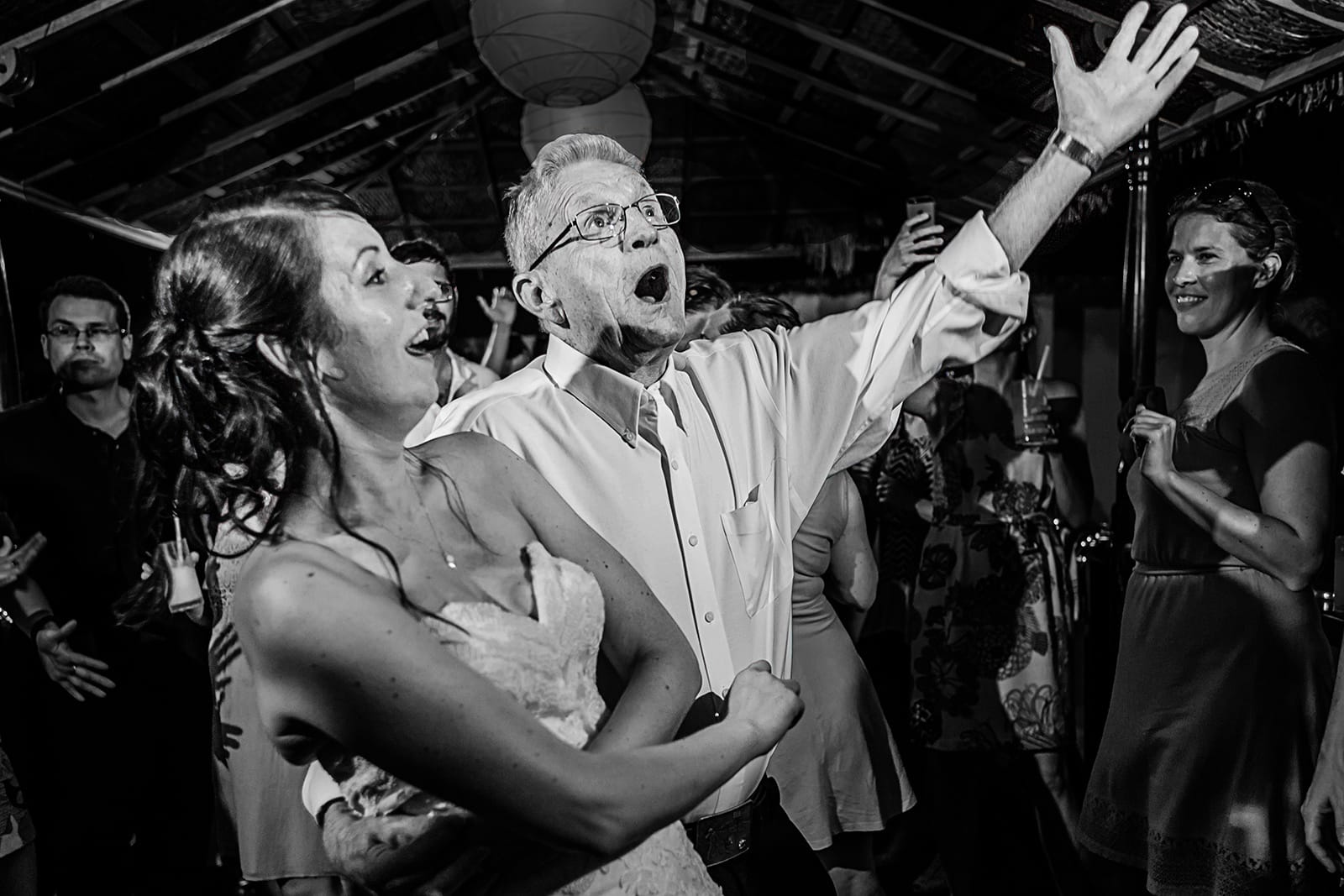Grandfather and bride dance at reception