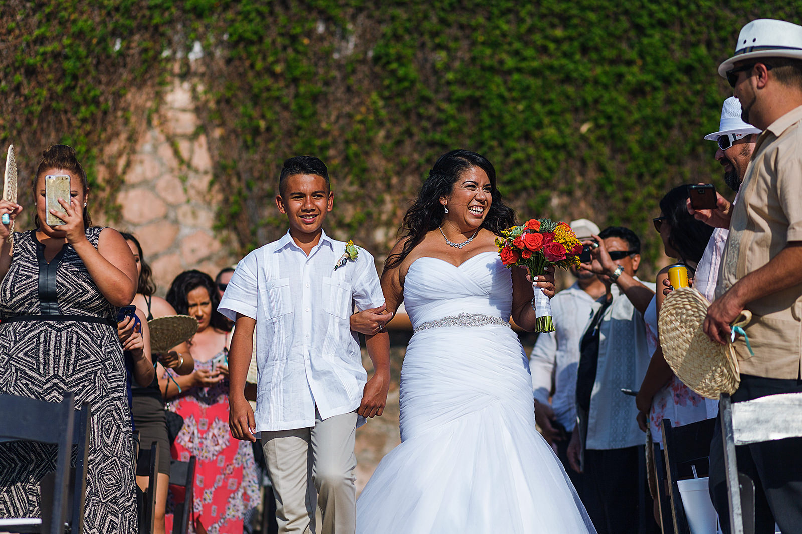 Bride and son walking down the aisle for wedding ceremony