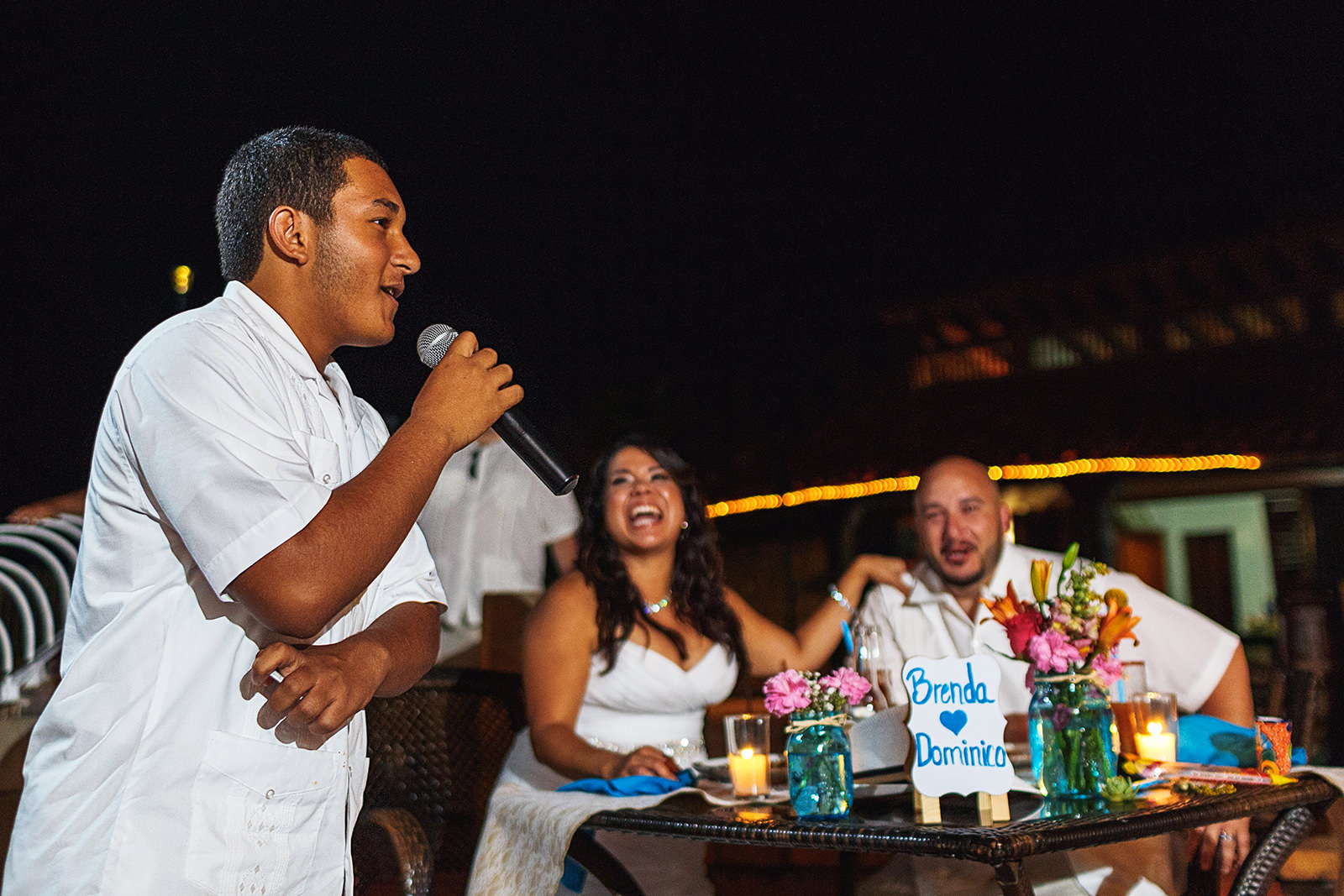 Guest, bride and groom during speech at Villa Celeste