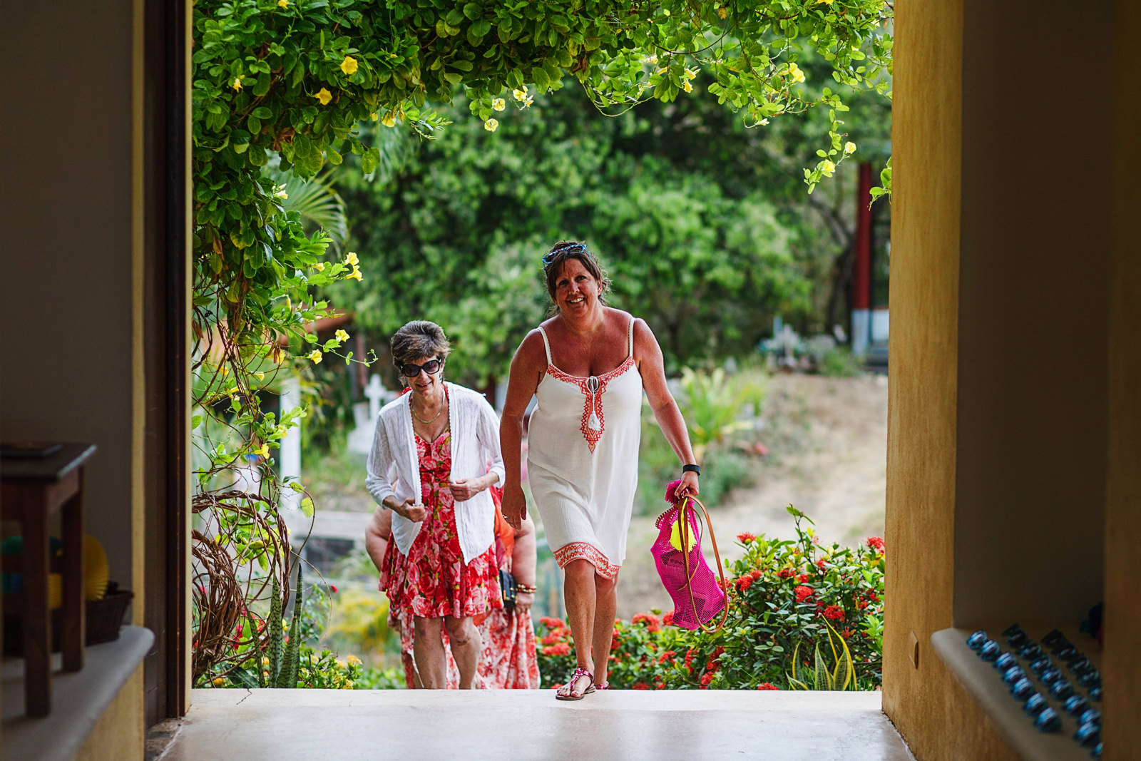 Wedding guests arriving to palapa in Sayulita Mexico for ceremony and reception