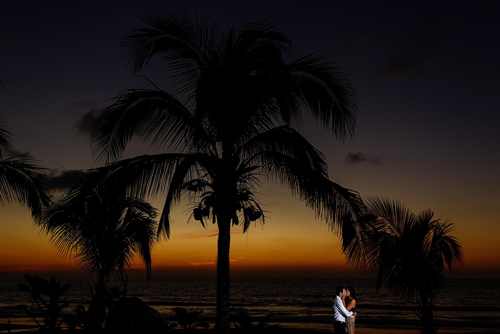 Couple kissing under dramatic sunset at Imanta Resort - Punta de Mita, Mexico