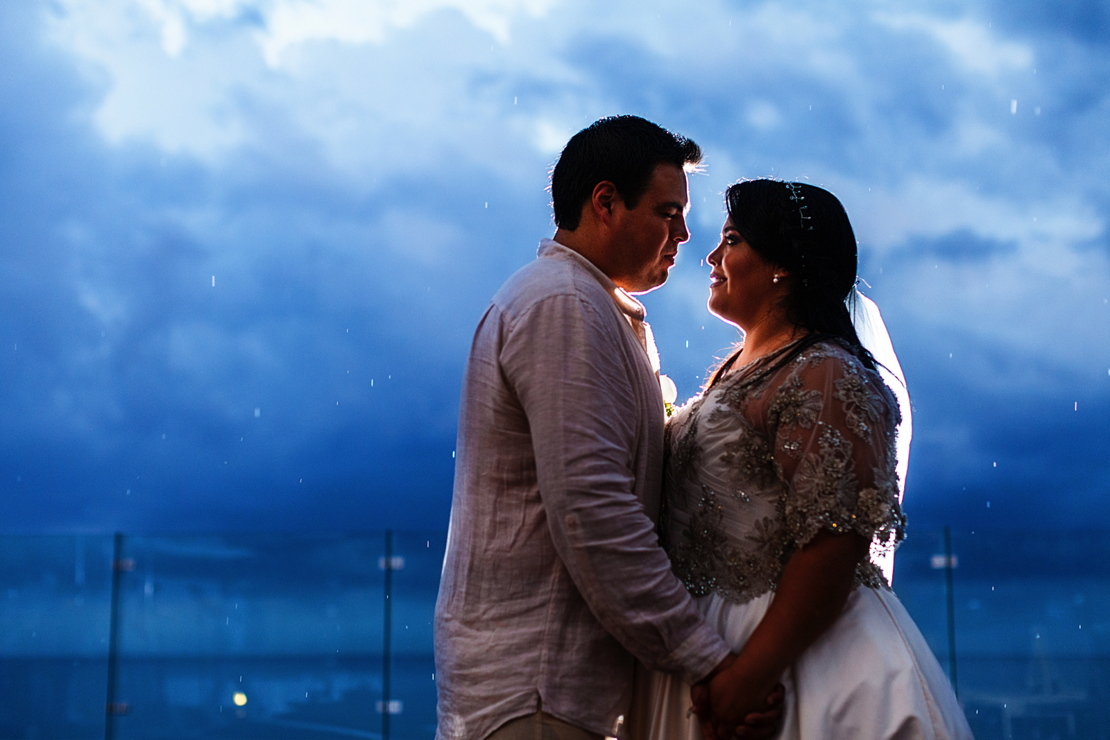 Couple standing on the rain backlight with flash - Iberostar Mexico