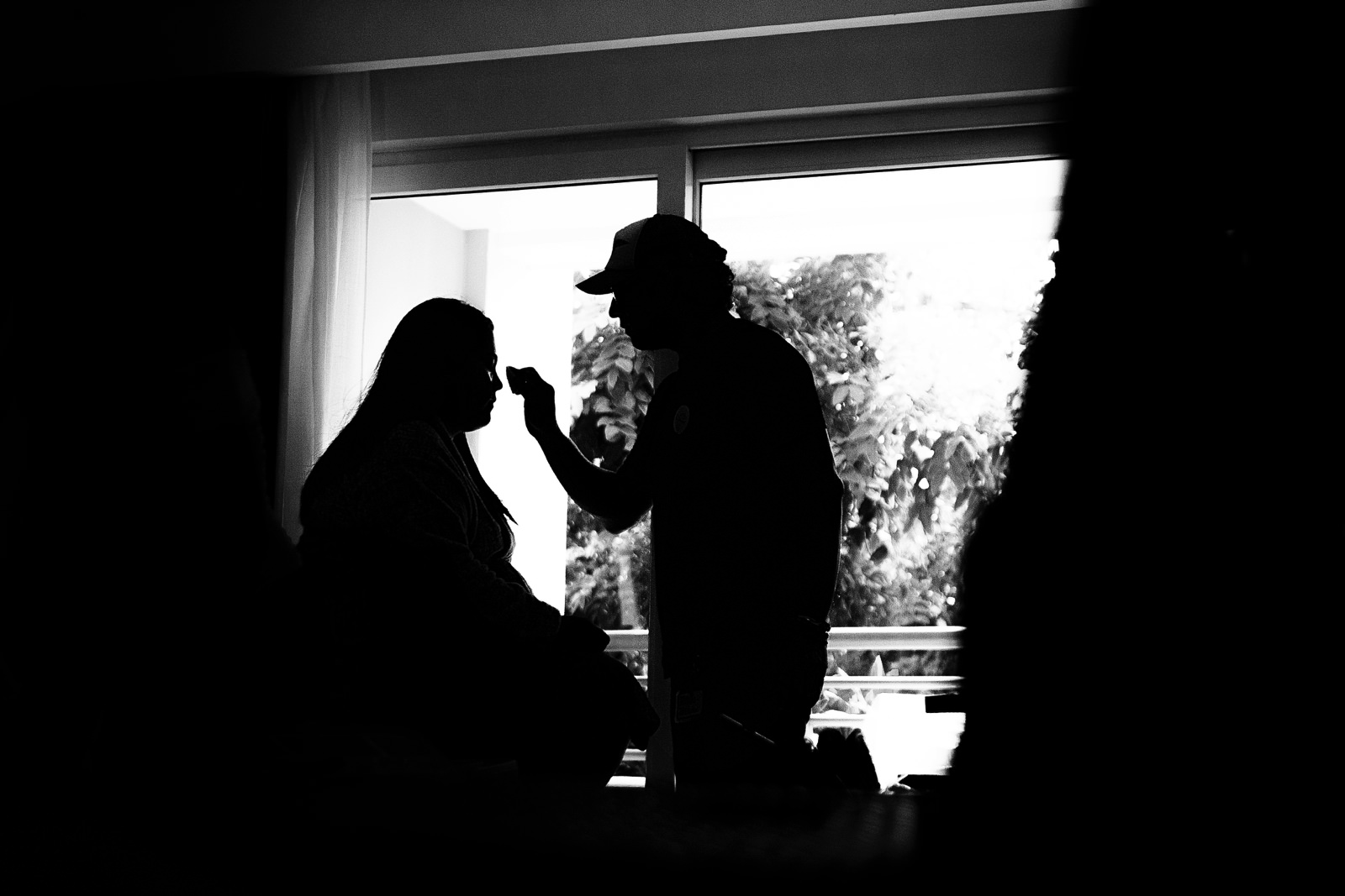Silhouette of the bride getting her make up before the ceremony