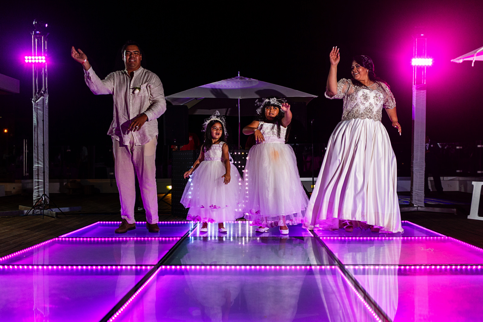 Bride, groom and daughters (flower girls) doing a dance for the guests as part of the first dance
